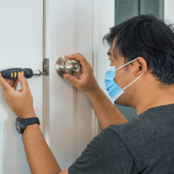 locksmith wearing a face mask